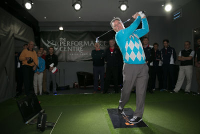 Former Ryder Cup captain Bernard Gallacher strikes the first shot from the UK's most advanced golf teaching facility at World of Golf in New Malden, London