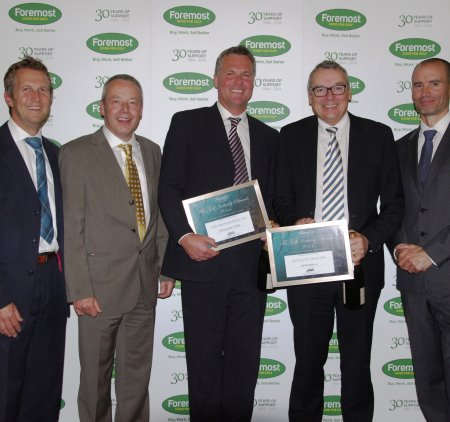 From left: Foremost company director Andy Martin and Chairman Chris Steele congratulate Motocaddy Sales Director Neil Parker and Chairman David Wells, with awards presenter Andrew Cotter