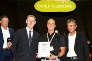 Tim DeJarlais for Swing Catalyst (centre) receives the award from Tony Bennett, director of education for the PGA of Europe (left) and Gerhard Reiter, CEO of Messe Augsburg (right)