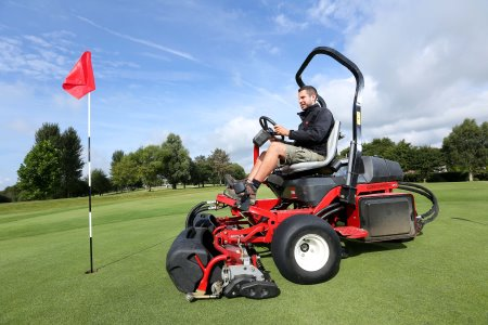 Greenkeeper at Highwoods Golf Club operating the recently purchased Toro Greensmaster 3250.