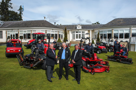 Scott Fenwick, centre, with Lely UK's account manager Trevor Chard, left, Scott McNeil from Henderson Grass Machinery and the greenkeepers with Toro equipment looking on