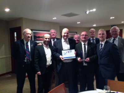 Alan McCloskey, fourth right, receiving his award with PGA of Scotland secretary Brian Mair pictured fourth from left