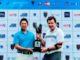 Sir Nick Faldo presents the 2013-2014 Faldo Series Asia trophy to Japan's Mikumu Horikawa