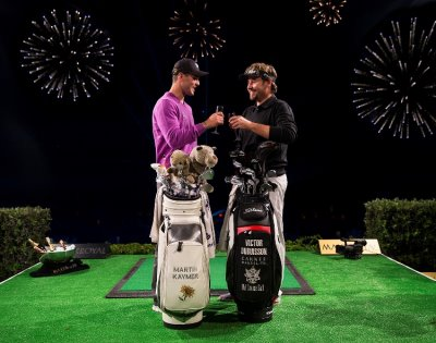Martin Kaymer and Victor Dubuisson celebrate the Maxx Royal Target Challenge