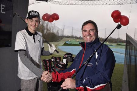 World of Golf Master Professional Jon Woodroffe (right) with golfer Callum Elliott ahead of his 50,000th lesson