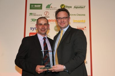 Edward Ainsworth (left) collects his award from Nick Brown of Ransomes Jacobsen