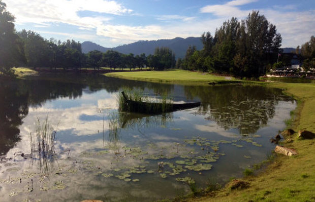A traditional Thai fishing boat in the water course beside the 7th hole;