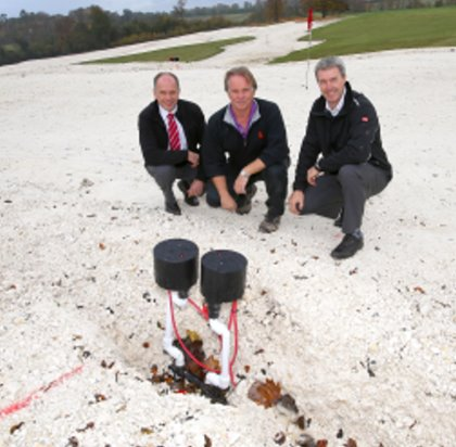 Tim Edwards, centre, with Lely's Jeff Anguige, left, and The Toro Company's Andrew Brown