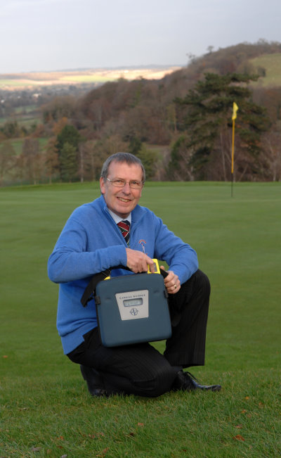 Picture of Temple Golf Club manager Matthew Wellings with the defibrillator which saved his life