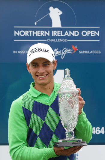 Sweden's Joakim Lagergren receiving the trophy after winning the 2014 NI Open at Galgorm Castle in Ballymena (Photo: PressEye)