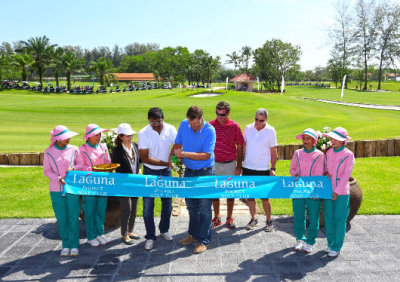 Ravi Chandran and Paul Jansen cut the ribbon to mark the official re-opening of the course