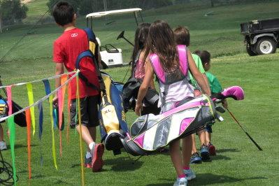 Broken Tee Group of kids with golf bags