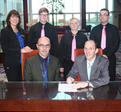 Bryan McCabe, foreground left, signs the agreement with Franck Bruyere, director of food and beverage at Fairmont St Andrews, watched by (l-r) the resort's human resources manager, Carol-Ann Hibbert, and students Josh Ford, Lynne Gilfillan and Keith Wallace