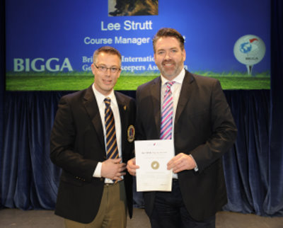 Lee (right) is presented with his certificate by CGSA President Christian Pilon
