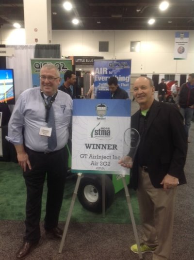 Richard Campey (left) and Air Inject President Glen Black receive the STMA award for the Most Innovative Product
