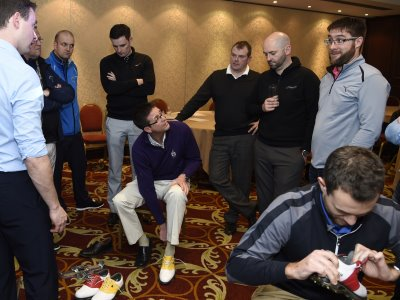 TGI Golf Partners enjoying a practical demonstration of shoe fitting from FootJoy University