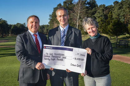 Crown Golf's Chief Operating Officer Stephen Towers (left) and the company's Group Retail and Academies Manager Caroline Griffiths with Brendon Pyle, Chief Executive Officer at The Golf Foundation