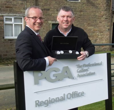 IME PLEASE! Gary Butler, right, shows a selection of his watches to PGA North secretary Graham Maly