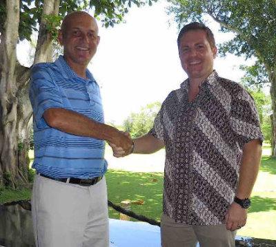 Mark Siegel (left) and Renato Domini shake hands on their new partnership