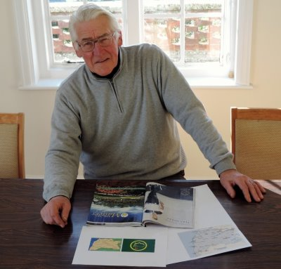 Thorpeness Golf Club Head Professional Frank Hill, photographed in the library with the map of Suffolk and the golf magazine that triggered his discovery
