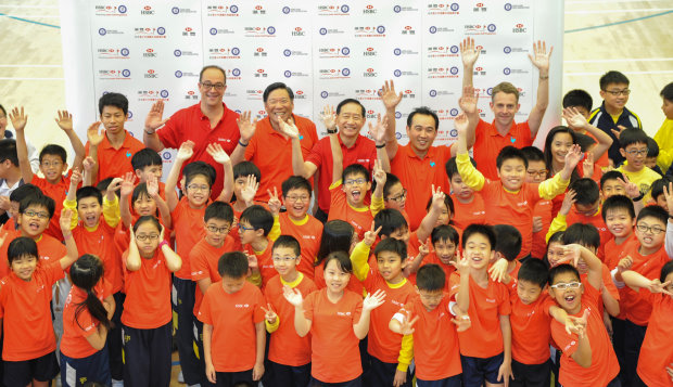 HSBC and the Hong Kong Golf Association launch the new HSBC Hong Kong Junior Golf Programme at the SKH St. James' Primary School. From left: Michael Regan Wong, HKGA National Squad member; Giles Morgan, Global Head of Sponsorship & Events, HSBC; Ning Li, President of the HKGA; Peter Wong, Deputy Chairman and Chief Executive Asia-Pacific, HSBC; David Hui, Honorary Chairman of the HKGA; Tom Phillips, CEO of the HKGA and Tiana Lau, HKGA National Squad member