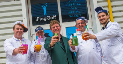 Neil Wilcox (in the green jacket) with his team at iPlayGolfUK