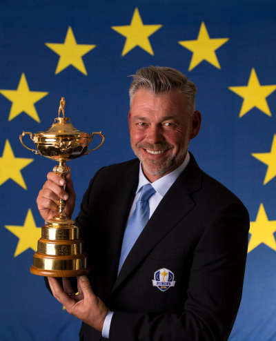 2016 European Ryder Cup Captain Darren Clarke of Northern Ireland poses with the Ryder Cup trophy during a Ryder Cup Photocall at the Sofitel hotel on March 23, 2015 in London, England.  (Photo by Richard Heathcote/Getty Images)