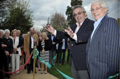 Tony Jacklin cuts the ribbon with Rick Cressman (owner of Nailcote Hall)