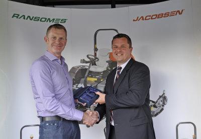 Fairways GM Managing Director, David Rae receives the Jacobsen sales award from Rupert Price