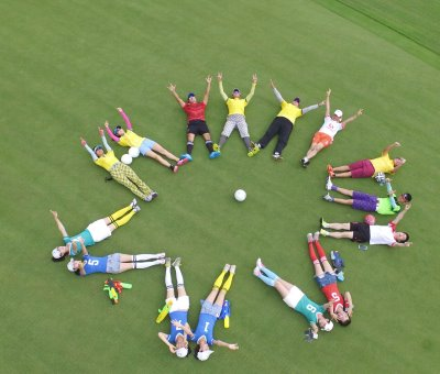Players and fans are pictured to form a football-shaped ball in support for China's first Footgolf championship at Mission Hills Shenzhen (photograph by Vincent Chu/Mission Hills)
