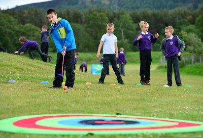 Macdonald Hotel Resorts - children practicing their golf skills