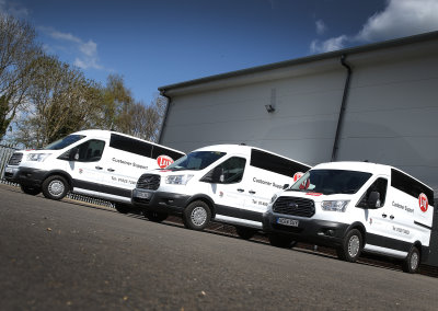 Three of Lely's new service vans pictured at the company's Sheffield Park service centre