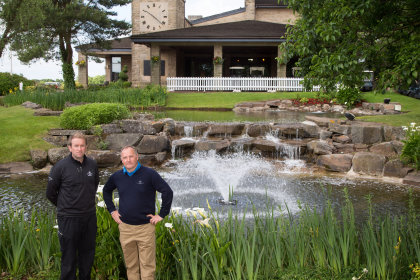 Noel O'Connell, Assistant Head of Irrigation and Special Projects, left, and Jim McKenzie MBE, Director of Golf Courses and Estate Management, with the new Otterbine water feature installed in the pond outside the Celtic Manor lodge golf clubhouse
