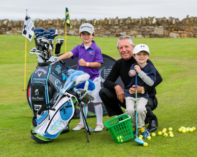 Jack Dirkin, Gary Player, Tommy Morrissey Junior golf sensations Jack Dirkin (5) and Tommy Morrissey (4) got to meet golf legend Gary Payer in St Andrews as they tried out new revolutionary kids golf clubs designed in Scotland. Five-year-old Jack from Shropshire, the UKs number one Under-5 golfer, has qualified for the World Under-6 championships in Pinehurst, Carolina, at the end of July 2015. Mean while Tommy, from Florida, who is already an internet and tv star due to his golfing ability despite being born without a right hand and lower arm. Golphin for Kids is a Scottish company whoes founder Calum McPherson invented a light weight golf club with a larger sweet spot to make it easier for kids to hit the ball well. Picture by John Young © www.youngmedia.co.uk 2015