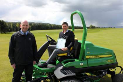 SRUC Elmwood Student of the Year Award 2015 winner Simon Dexter with John Deere dealer Sandy Armit of The Double A Trading Company Ltd