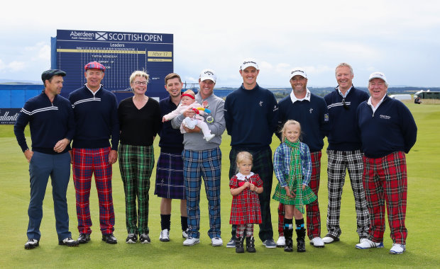 GULLANE, SCOTLAND - JULY 08: (L-R) Actor Dougray Scott, Rugby Player Gavin Hastings, Mindroom Charity Founder Sophie Dow, Chris McGregor and 8-month-old daughter Eloise (third place) held by Marc Warren of Scotland, Justin Rose of England, Ryan Palmer of the United States, Comedian Rory Bremner, CEO of Aberdeen Asset Management Martin Gilbert, 3-year-old Jessica Donaldson (first place, front L) of Pencaitland and 8-year-old Emma Rule (second place, front R) of Paisley pose for a photo during Tartan Wednesday prior to the start of the Aberdeen Asset Management Scottish Open at Gullane Golf Club on July 8, 2015 in Aberdeen, Scotland.  (Photo by Jan Kruger/Getty Images)