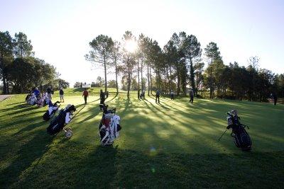 Golfers on the putting green at PGA Catalunya Resort