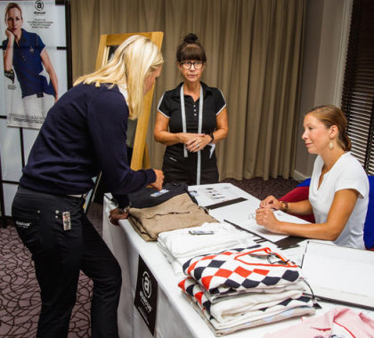 Carin Koch, European Team Captain (left), with abacus representatives at The Solheim Cup team fitting session
