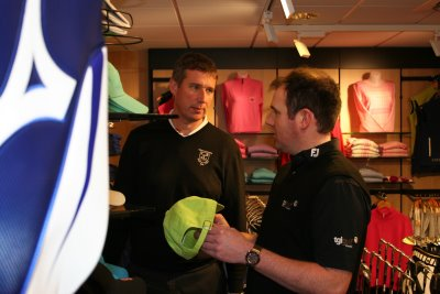 TGI Golf Retail Consultant Paul Hay discusses shop layout with North Berwick PGA Professional Martyn Huish