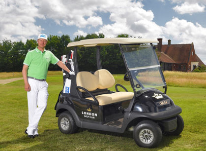 Mikko Ilonen, winner of the 2014 Volvo World Match Play Championship at London Golf Club, prior to a round with one of the venue's Club Car vehicles