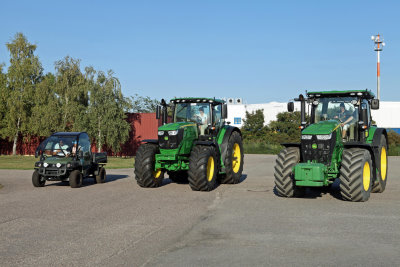 Melissa Reid, Caroline Masson and Maria Hjorth take instruction on driving the John Deere Gator and 6R & 7R Series tractors at the company's Bruchsal test track in Germany