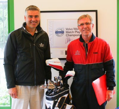 Dennis Excell on the right is presented his retirement gift of a set of golf clubs by Peter Todd, course manager at London Golf Club.