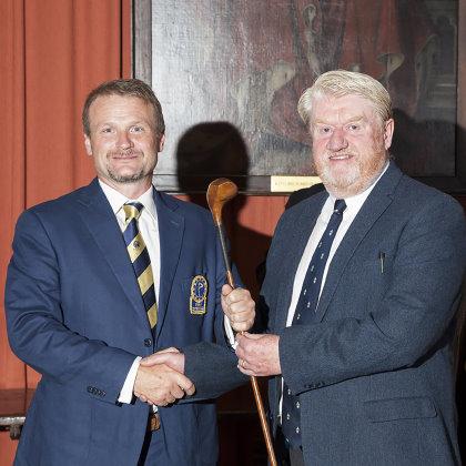 EIGCA President Tom Mackenzie receiving the Tri-Continent match trophy from Peter MacEvoy