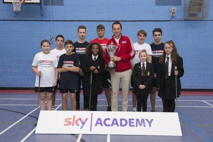 Nick Dougherty unveils the new British Masters trophy on a visit to The Buckingham School (Getty Images)