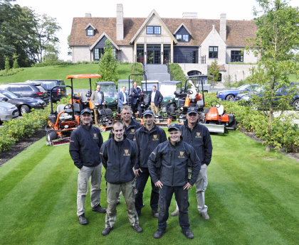 Superintendent John van Hoesen (back right) with his greenkeeping team
