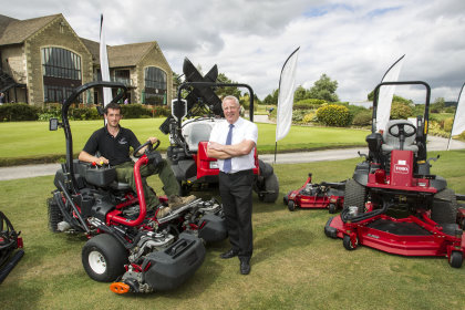 Cumberwell Park Golf Club's course manager Matt James, seated, with Lely's Robert Rees and a selection of the club's first Toros in a new deal