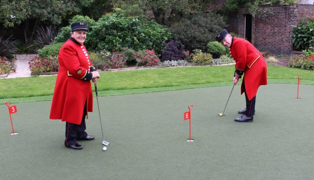 Chelsea Pensioners Audrey Merton and Douggie Payne enjoy their new Huxley Golf putting green