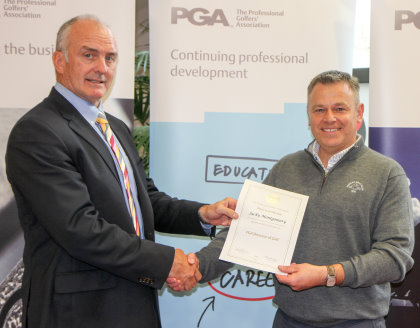 Dr Kyle Phillpots, left, presenting the PGA director of golf certificate to Jacky Montgomery (picture courtesy of Adrian Milledge)