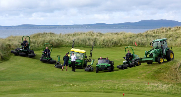 Machrie Golf Links course manager Dean Muir with Nairn Brown Ltd sales manager Andy Gillies (standing left & right), with the greenkeeping staff and a selection of their new John Deere machines