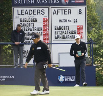 Matthew Fitzpatrick consult The Green Book on his way to victory in The British Master at Woburn